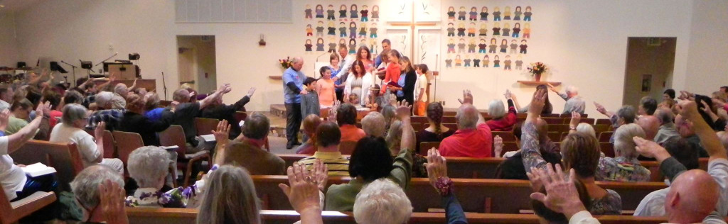 church raising hands